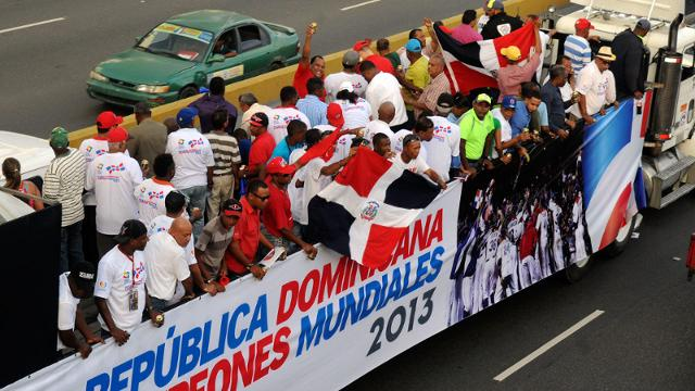 Dominican Republic baseball players and fans celebrate during the World Baseball Classic victory parade Thursday.