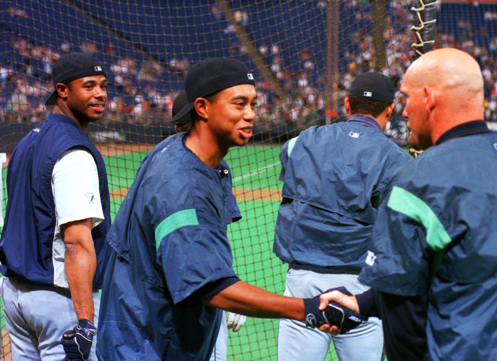 3741ae48c7 Yes, that's Tiger Woods shaking Jay Buhner's hand as a smiling Ken Griffey  Jr. looks on. Junior, 29, had a typical 31 homers, 86 RBIs and  .306/.398/.609 ...
