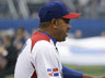 The Dominican Republic's manager Tony Pena, left, shakes hands with Puerto Rico manager Edwin Rodriguez before the championship game of the World Baseball Classic in San Francisco, Tuesday, March 19, 2013. (AP Photo/Ezra Shaw, Pool)