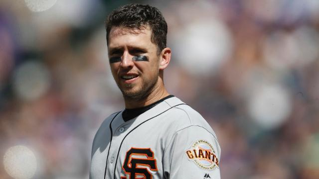 San Francisco Giants catcher Buster Posey (28) in the sixth inning of a baseball game Sunday, April 23, 2017, in Denver. Colorado won 8-0. (AP Photo/David Zalubowski)