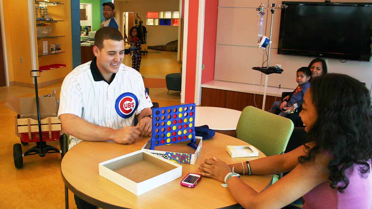 Rizzo visits young patients, including ones with cancer