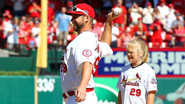 Cards hand ball to Carp for ceremonial pitch