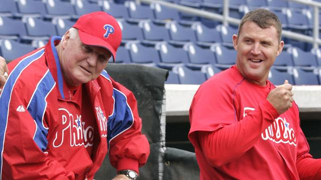 Philadelphia Phillies manager Charlie Manuel, left, and first baseman Jim Thome take a break during spring training camp Saturday, Feb. 26, 2005, in Clearwater, Fla. (AP Photo/Rusty Kennedy)