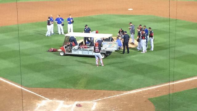 Chapman carried off on stretcher after hit in head