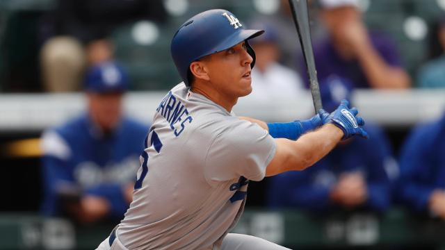 Los Angeles Dodgers catcher Austin Barnes (15) in the seventh inning of a baseball game Sunday, Oct. 1, 2017, in Denver. The Dodgers won 6-3. (AP Photo/David Zalubowski)