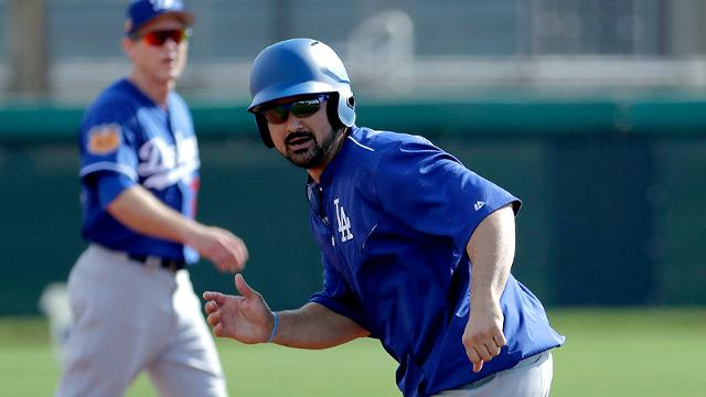 Adrian Gonzalez expects to play for Team Mexico once he is cleared by Dodgers physicians. (AP)