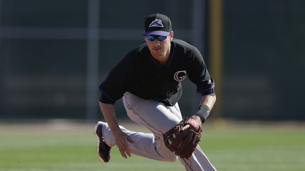 Janish homers as Rockies split day's action