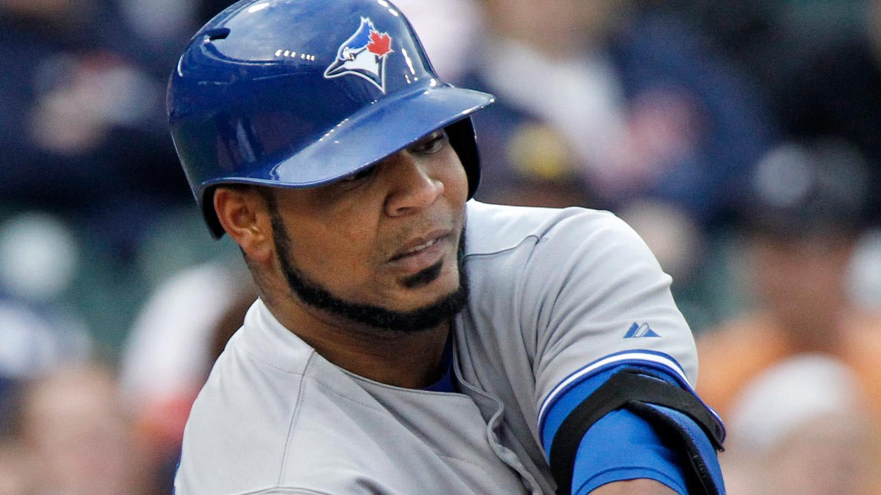 Encarnacion day to day due to tight back