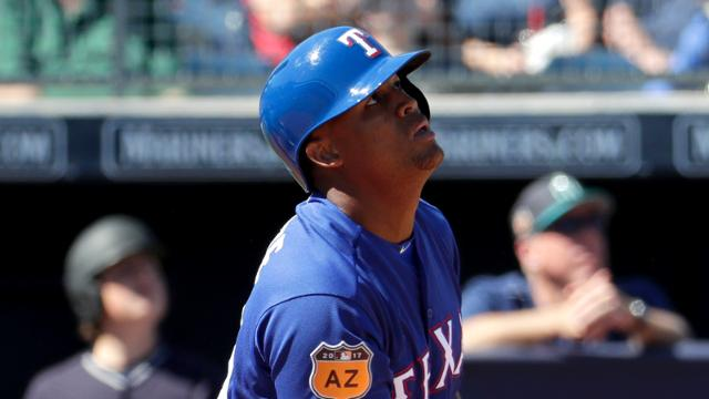 Texas Rangers' Adrian Beltre hits during the first inning of a spring training baseball game against the Seattle Mariners, Monday, March 6, 2017, in Peoria, Ariz. (AP Photo/Matt York)