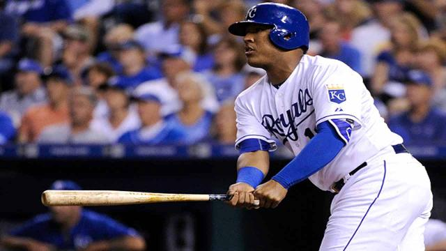 KANSAS CITY, MO - SEPTEMBER 26: Salvador Perez #13 of the Kansas City Royals hits a RBI double in the fourth inning at Kauffman Stadium on September 26, 2015 in Kansas City, Missouri. (Photo by Ed Zurga/Getty Images)