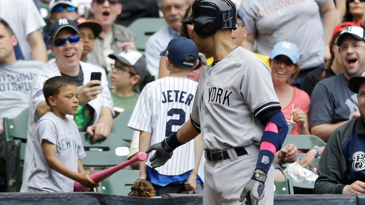 Jeter gives pink bat to young fan in stands
