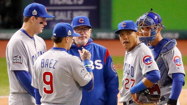 CLEVELAND, OH - OCTOBER 25: Manager Joe Maddon #70 talks with Javier Baez #9 and Addison Russell #27 of the Chicago Cubs against the Cleveland Indians in Game One of the 2016 World Series at Progressive Field on October 25, 2016 in Cleveland, Ohio. (Photo by Gregory Shamus/Getty Images)