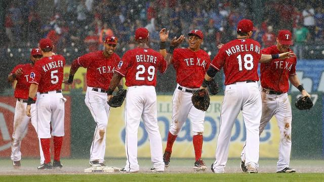 Rangers survive ninth-inning downpour in Arlington