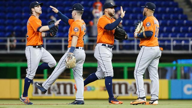 Houston Astros players celebrate after the Astros defeated the Miami Marlins 3-0 in a baseball game, Wednesday, May 17, 2017, in Miami. From left, Josh Reddick, Alex Bregman, George Springer, and Yuli Gurriel. (AP Photo/Wilfredo Lee)