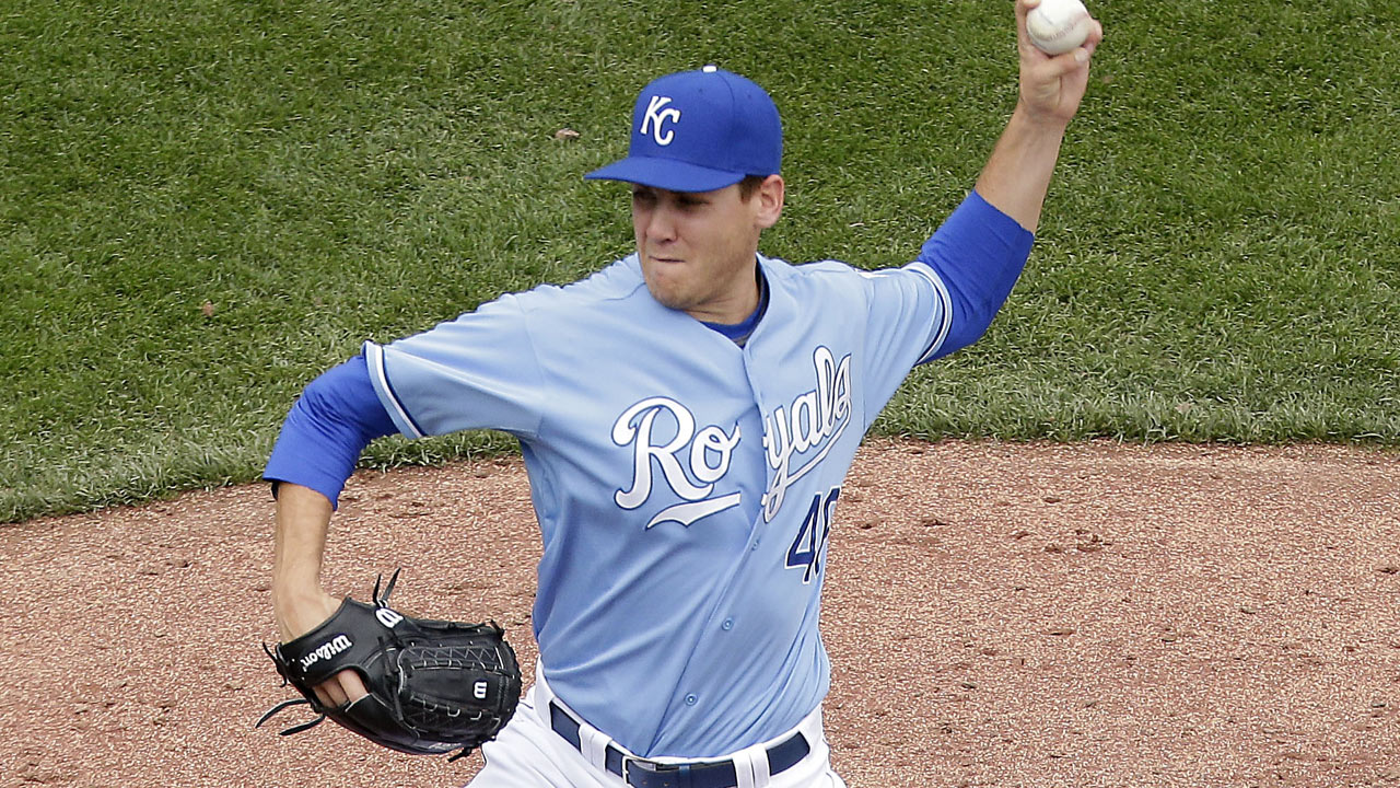 Royals deal Marks back to A's for cash