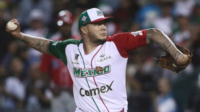 Mexico's Aguilas de Mexicali starting pitcher Hector Velazquez throws the ball in the first inning of the Caribbean Series baseball championship title game against Puerto Rico's Criollos de Caguas, in Culiacan Mexico, Tuesday, Feb. 7, 2017. (AP Photo/Luis Gutierrez)