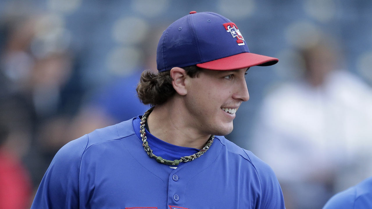 Holland not quite ready to rejoin Rangers' rotation