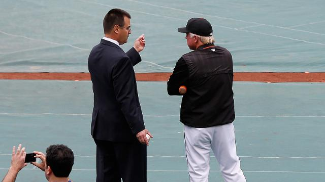Dan Duquette leaves game management to Buck Showalter, who welcomes the wealth of data from Duquette's office in his decision-making. (Getty)