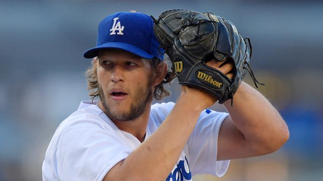 Los Angeles Dodgers starting pitcher Clayton Kershaw winds up during the first inning of a baseball game against the Milwaukee Brewers, Saturday, Aug. 16, 2014, in Los Angeles. (AP Photo/Mark J. Terrill)