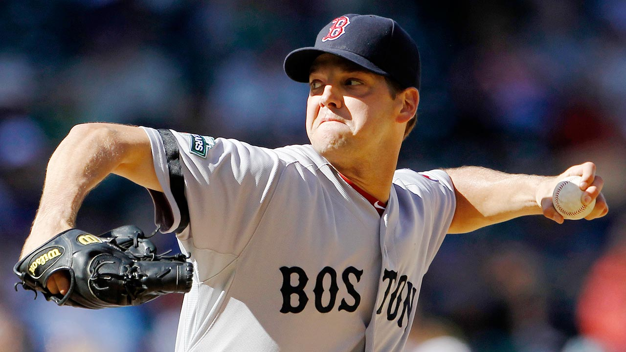 Hill reports to Red Sox after death of newborn son