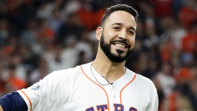 Houston Astros' Marwin Gonzalez tosses his helmet after flying out against the Boston Red Sox during the third inning in Game 3 of a baseball American League Championship Series on Tuesday, Oct. 16, 2018, in Houston. (AP Photo/David J. Phillip)