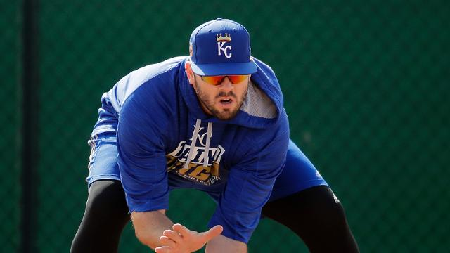 Kansas City Royals' Mike Moustakas fields a ball during spring training baseball practice Tuesday, Feb. 14, 2017, in Surprise, Ariz. (AP Photo/Charlie Riedel)