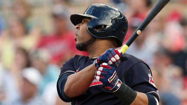 Cleveland Indians' Edwin Encarnacion watches his RBI double off Minnesota Twins pitcher Jake Odorizzi during the first inning of a baseball game Thursday, May 31, 2018, in Minneapolis. (AP Photo/Jim Mone)