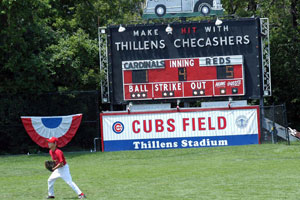 An outfielder appears game ready at Cubs Field at Thillens Stadium.