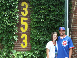 A couple explores the historic Ivy in right field at Wrigley Field.
