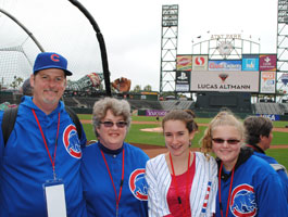 A family enjoys the view from the warning track at AT&T Park in San Francisco.