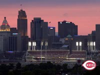 The ballpark in front of the skyline at dusk