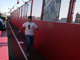 A fan running down the track
