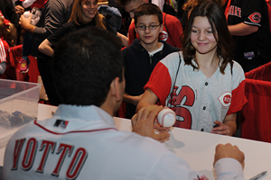 Votto signs for a fan
