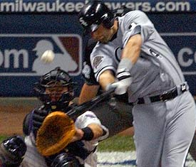 Paul Konerko hits a two-run double off Byung-Hyun Kim in the seventh inning. (Morry Gash/AP)