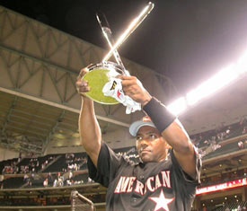 Miguel Tejada holds up his trophy after winning the 2004 Home Run Derby.