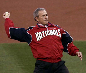 President George Bush throwing out the first pitch
