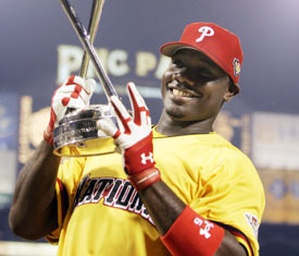 Ryan Howard holds the Derby championship trophy on Monday night.