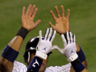 Robinson Cano is met by Derek Jeter (2) after scoring the winning run on Sunday.