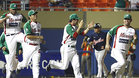 Mexico celebrates after its 3-2 win over Venezuela on Monday.