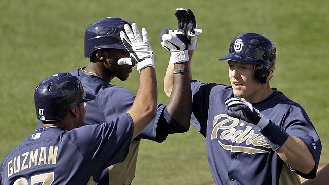Hundley's slam leads Padres' wild opener