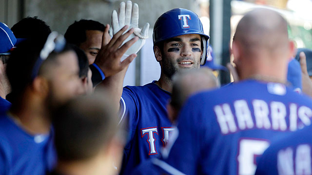 Martin homers as Rangers rack up 19 hits