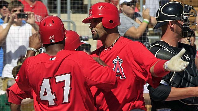 Pujols homers twice, Santana hurt in loss