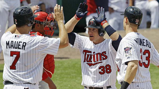 Homers by Morneau, Hughes lead Twins' romp