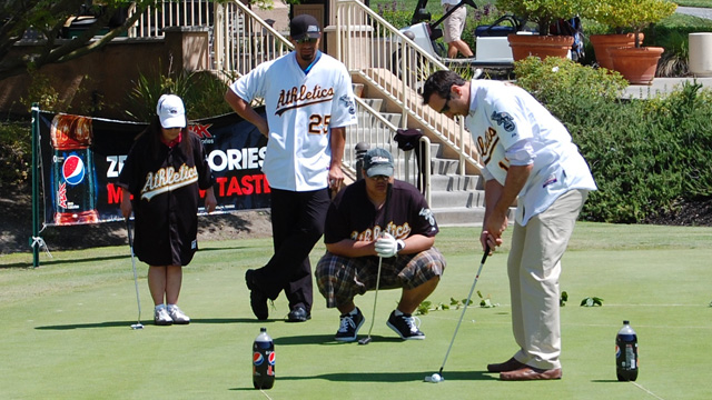 A's players give back at Golf Classic