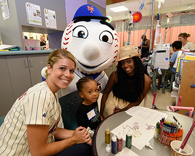 METS WIVES VISIT COHEN CHILDREN'S MEDICAL CENTER