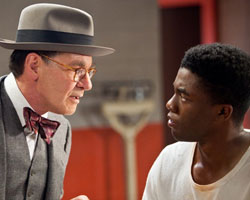 Jackie Robinson (Chadwick Boseman) and Branch Rickey (Harrison Ford)