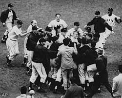 Bobby Thomson is mobbed by his Giants teammates after his three-run homer secured the pennant.