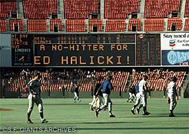 As the dejected New York Mets leave the field, the scoreboard proclaims Ed Halicki's feat.