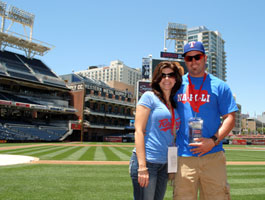A couple stands on the field at Petco Park in San Diego
